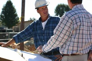 Contractor talking with home owner about Radon Mitigation systems