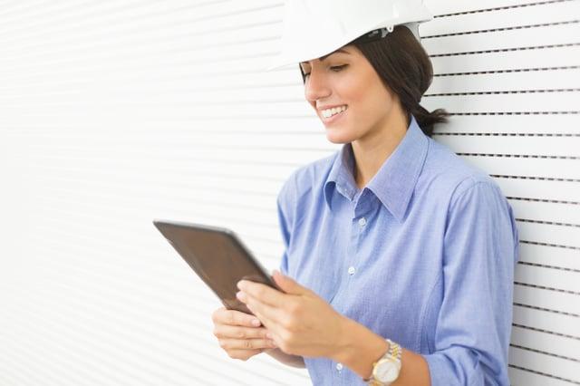 Woman Contractor Planning Radon Mitigation