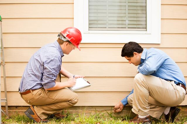 Inspectors looking for radon entry points